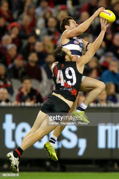 Matt Dea of the Bombers spoils Daniel Menzel of the Cats during the round eight AFL match between the Essendon Bombers and the Geelong Cats at...