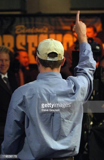 Matt Dean signals to his supporters after he was eliminated in the 2004 World Series of Poker at Binion's Horseshoe Club and Casino in Las Vegas...