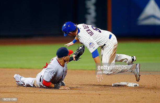Matt den Dekker of the New York Mets is caught stealing second base in the sixth inning by Ian Desmond of the Washington Nationals at Citi Field on...