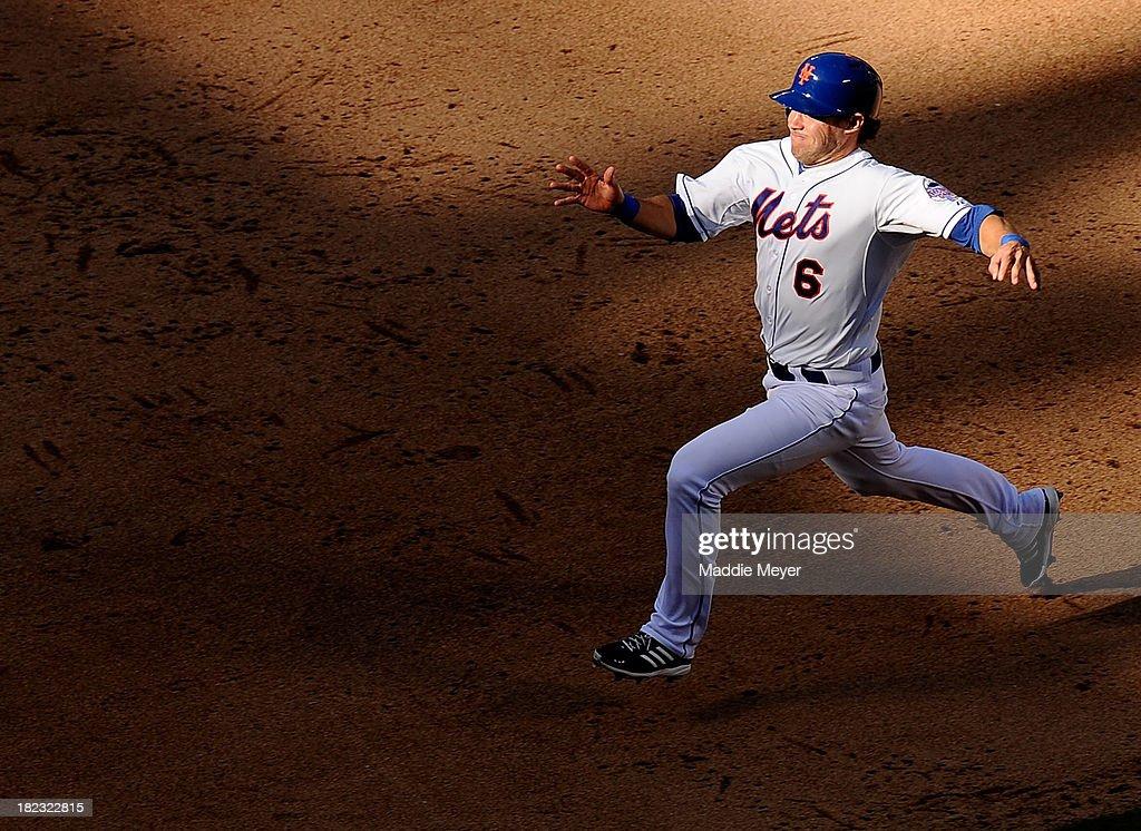 Matt den Dekker #6 of the New York Mets runs towards third during the ninth inning against the Milwaukee Brewers at Citi Field on September 29, 2013 in New York City.