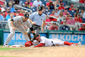 Matt den Dekker of the Washington Nationals is tagged out at third base in the eighth inning by Martin Prado of the Miami Marlins at Nationals Park...