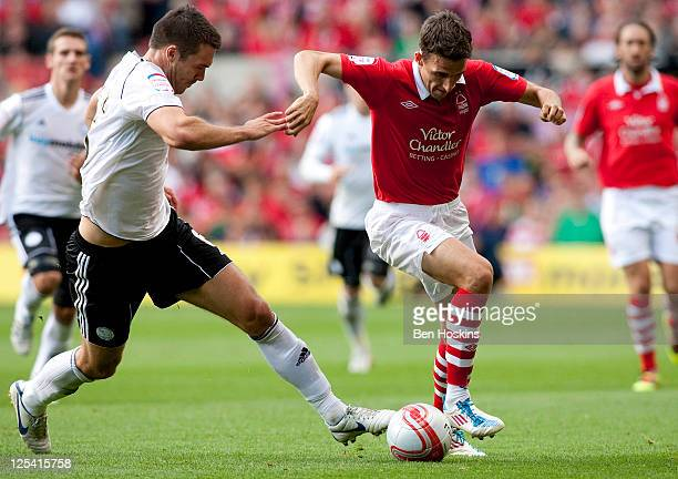 Matt Derbyshire of Nottingham skips past the challenge of Jason Shackell of Derby County during the npower Championship match between Nottingham...