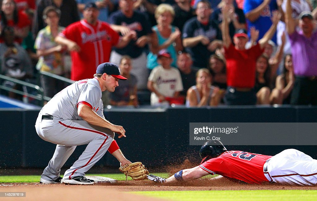 <a gi-track='captionPersonalityLinkClicked' href=/galleries/search?phrase=Matt+Diaz&family=editorial&specificpeople=225174 ng-click='$event.stopPropagation()'>Matt Diaz</a> #23 of the Atlanta Braves is tagged out at third base by <a gi-track='captionPersonalityLinkClicked' href=/galleries/search?phrase=Ryan+Zimmerman+-+Baseball+Player&family=editorial&specificpeople=534809 ng-click='$event.stopPropagation()'>Ryan Zimmerman</a> #11 of the Washington Nationals after scoring two runs at Turner Field on May 25, 2012 in Atlanta, Georgia.