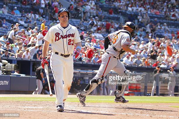 Matt Diaz of the Atlanta Braves strikes out to end the game as Ronny Paulino of the Baltimore Orioles heads to the mound during the interleague game...