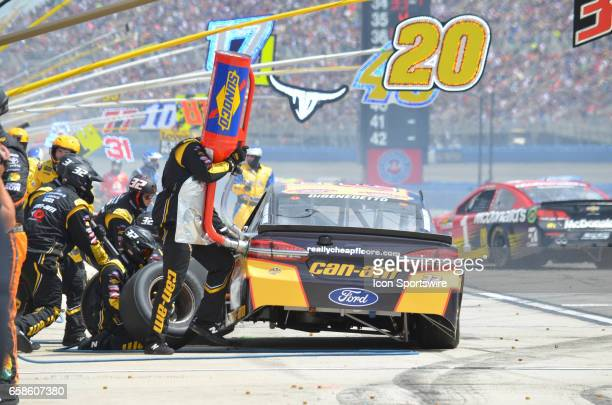 Matt DiBenedetto CanAm/Kappa Ford Crew Chief Gene Nead GO FAS Racing pits for tires and fuel at the NASCAR Monster Energy Cup Series Auto Club 400 on...
