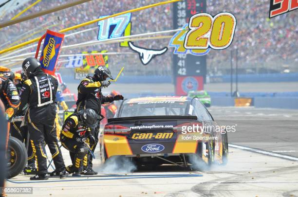 Matt DiBenedetto CanAm/Kappa Ford Crew Chief Gene Nead GO FAS Racing burns out of the pit box after taking on tires and fuel at the NASCAR Monster...