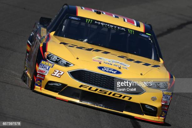 Matt DiBenedetto driver of the CanAm/Kappa Ford drives during practice for the Monster Energy NASCAR Cup Series Auto Club 400 at Auto Club Speedway...