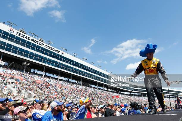 Matt DiBenedetto driver of the CanAm/Kappa Ford greets fans during driver introductions prior to the Monster Energy NASCAR Cup Series O'Reilly Auto...