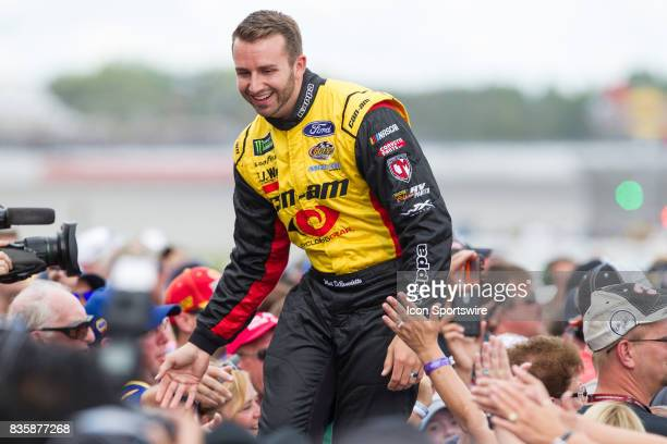 Matt DiBenedetto driver of the CanAm/Kappa Ford greets fans during the prerace ceremonies of the Monster Energy NASCAR Cup Series Pure Michigan 400...
