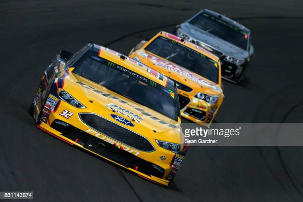 Matt DiBenedetto driver of the CanAm/Kappa Ford leads a pack of cars during the Monster Energy NASCAR Cup Series Pure Michigan 400 at Michigan...