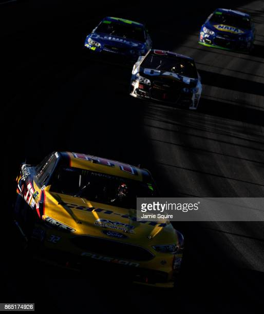 Matt DiBenedetto driver of the CanAm/Kappa Ford leads a pack of cars during the Monster Energy NASCAR Cup Series Hollywood Casino 400 at Kansas...