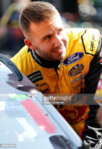 Matt DiBenedetto driver of the CanAm/Kappa Ford stands in the garage area during practice for the Monster Energy NASCAR Cup Series Alabama 500 at...