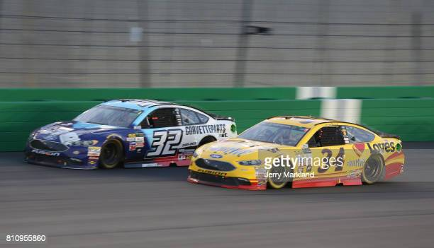 Matt DiBenedetto driver of the Corvettepartsnet/Anest Iwata Ford leads Landon Cassill driver of the Love's Travel Stops Ford during the Monster...