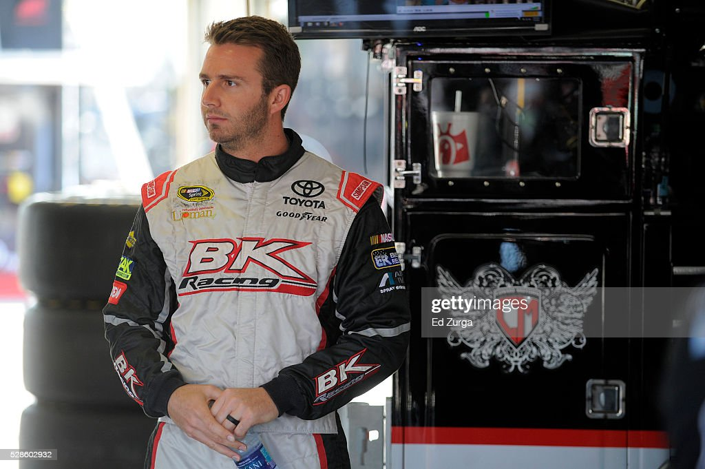 Matt DiBenedetto, driver of the #83 Cosmo Motors Toyota, looks on during practice for the NASCAR Sprint Cup Series Go Bowling 400 at Kansas Speedway on May 6, 2016 in Kansas City, Kansas.