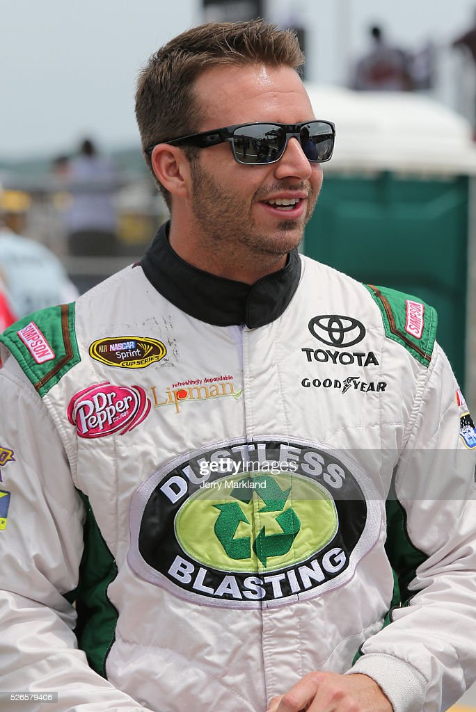 Matt DiBenedetto, driver of the #83 Dustless Blasting Toyota, stands on the grid during qualifying for the NASCAR Sprint Cup Series GEICO 500 at Talladega Superspeedway on April 30, 2016 in Talladega, Alabama.
