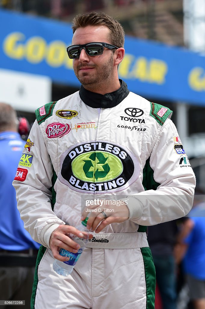 Matt DiBenedetto, driver of the #83 Dustless Blasting Toyota, walks on the grid during qualifying for the NASCAR Sprint Cup Series GEICO 500 at Talladega Superspeedway on April 30, 2016 in Talladega, Alabama.