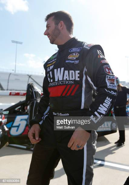 Matt DiBenedetto driver of the EJ Wade Construction Ford stands by his car during qualifying for the Monster Energy NASCAR Cup Series Toyota Owners...