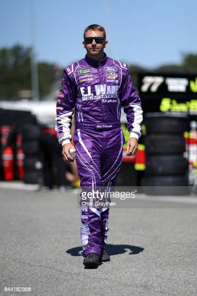 Matt DiBenedetto driver of the EJ Wade Construction Ford stands in the garage area during Practice for the Monster Energy NASCAR Cup Series Federated...