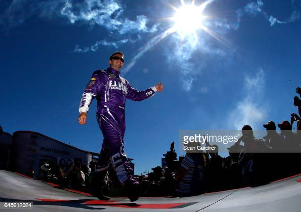 Matt DiBenedetto driver of the EJ Wade Construction Ford walks the onstage during driver introductions before the 59th Annual DAYTONA 500 at Daytona...