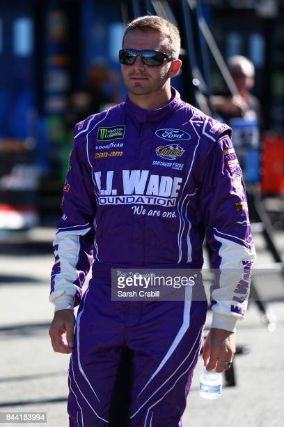 Matt DiBenedetto driver of the EJ Wade Construction Ford walks to his car prior to practice for the Monster Energy NASCAR Cup Series Federated Auto...