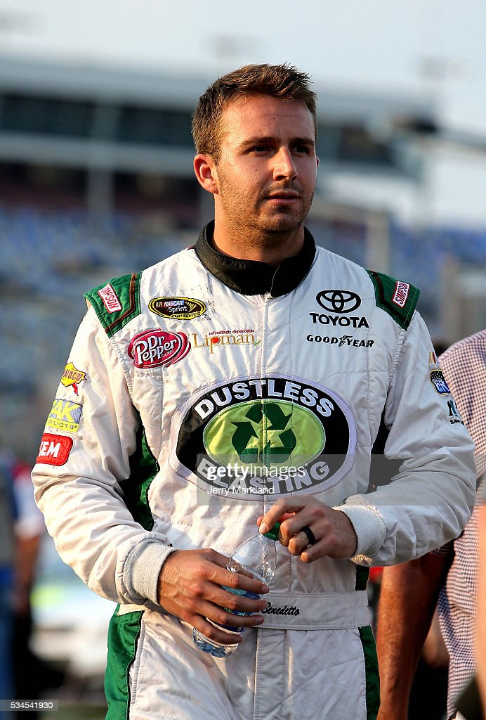 Matt DiBenedetto, driver of the #83 Hope For The Warriors/Cosmo Motors Toyota, stands on the grid during qualifying for the NASCAR Sprint Cup Series Coca-Cola 600 at Charlotte Motor Speedway on May 27, 2016 in Charlotte, North Carolina.