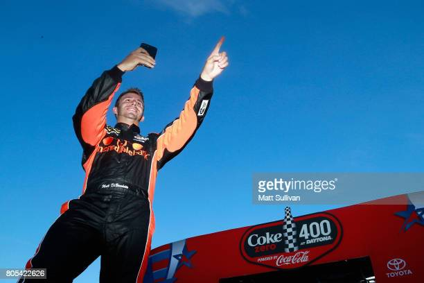Matt DiBenedetto driver of the Incredible Bank Ford greets fans as he is introduced prior to the Monster Energy NASCAR Cup Series 59th Annual Coke...