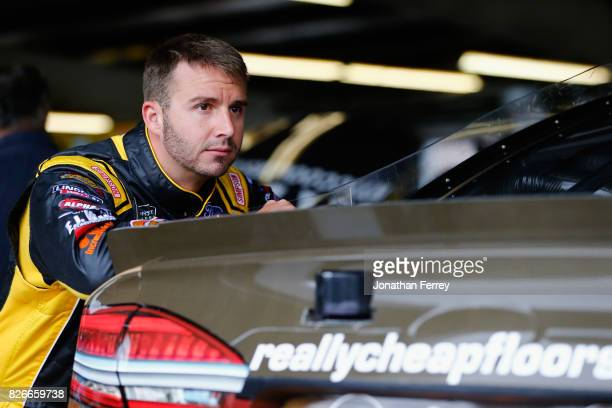 Matt DiBenedetto driver of the Incredible Bank Ford stands in the garage area during practice for the Monster Energy NASCAR Cup Series I Love NY 355...