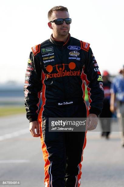 Matt DiBenedetto driver of the Incredible Bank/Ninja Turtles Samurai Ford walks on the grid during qualifying for the NASCAR Camping World Truck...