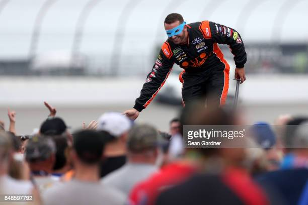 Matt DiBenedetto driver of the Incredible Bank/Ninja Turtles Samurai Ford is introduced prior to the Monster Energy NASCAR Cup Series Tales of the...