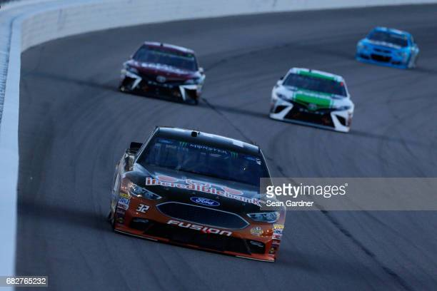 Matt DIBenedetto driver of the IncredibleBankcom Ford leads a pack of cars during the Monster Energy NASCAR Cup Series Go Bowling 400 at Kansas...