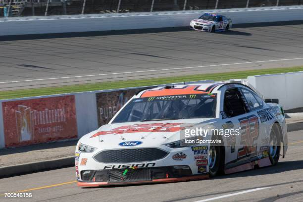 Matt DiBenedetto driver of the Keen Parts Ford enters the pits during the Monster Energy Cup Series Firekeepers Casino 400 race on June 18 2017 at...