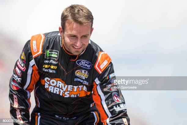 Matt DiBenedetto driver of the Keen Parts Ford greets fans during the driver introductions ceremony prior to the start of the Monster Energy Cup...