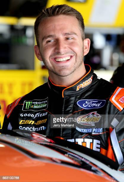 Matt DiBenedetto driver of the Keen Parts Ford looks on from the garage during practice for the Monster Energy NASCAR Cup Series STP 500 at...