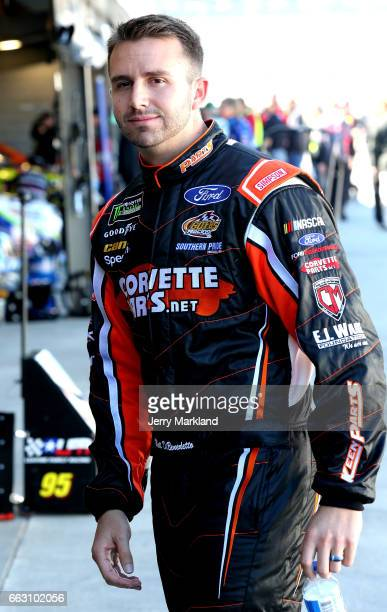 Matt DiBenedetto driver of the Keen Parts Ford looks on from the garage area during practice for the Monster Energy NASCAR Cup Series STP 500 at...