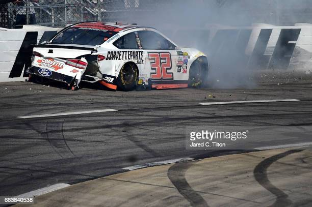 Matt DiBenedetto driver of the Keen Parts Ford wrecks during the Monster Energy NASCAR Cup Series STP 500 at Martinsville Speedway on April 2 2017 in...