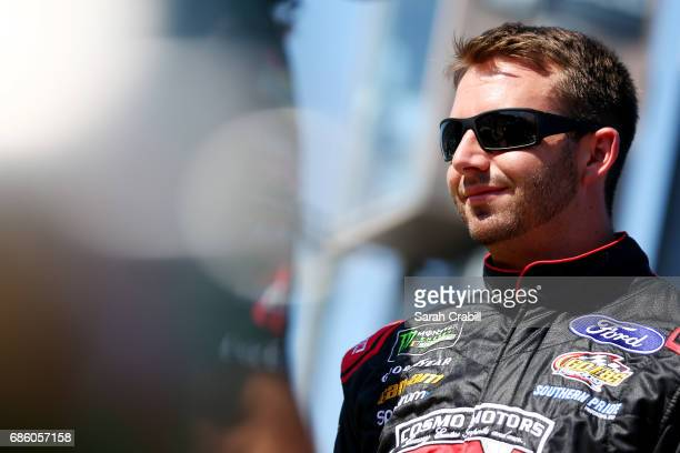 Matt DiBenedetto driver of the Reddit Ford stands on the grid during the Monster Energy NASCAR Open Qualifying at Charlotte Motor Speedway on May 20...