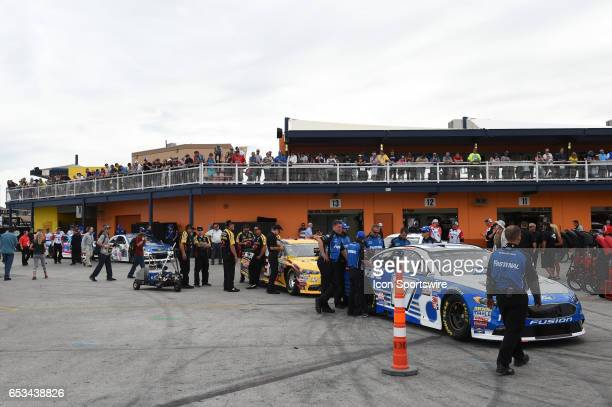Matt DiBenedetto GO FAS Racing Ford Fusion and Ricky Stenhouse Jr Roush Fenway Racing Ford Fusion prepare for inspection during Stratosphere Pole Day...