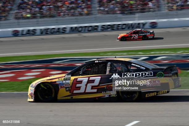 Matt DiBenedetto heads out of on pit road as Martin Truex Jr heads towards turn one during the Monster Energy NASCAR Cup Series Kobalt 400 race on...