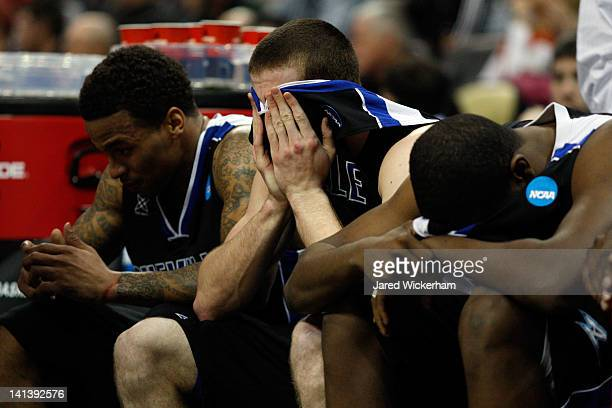 Matt Dickey of the UNC Asheville Bulldogs reacts from the bench against the Syracuse Orange during the second round of the 2012 NCAA Men's Basketball...