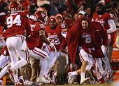 Matt Dimon Steven Parker and Baker Mayfield of the Oklahoma Sooners celebrate a failed twopoint conversion by the TCU Horned Frogs in the fourth...