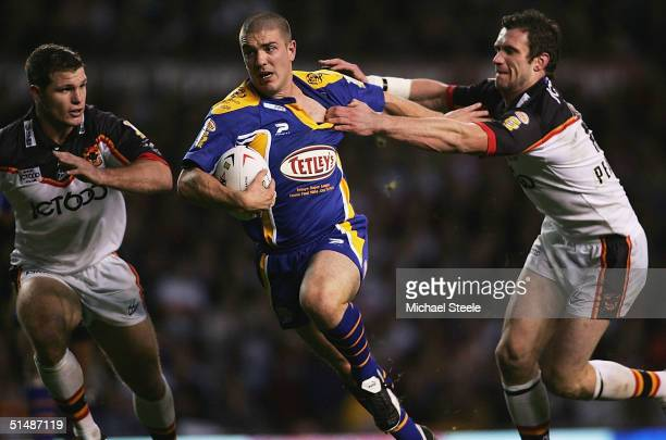 Matt Diskin of Leeds on his way to scoring the first try as Jamie Peacock of Bradford fails to stop him during the Tetley's Super League Grand Final...