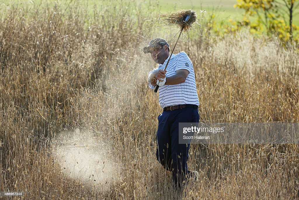 Matt Dobyns of the United States team hits a shot from the fescue on the 17th hole during the Friday Foursomes matches at the 27th PGA Cup at...