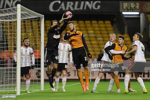 Matt Doherty of Wolverhampton Wanderers and Marcus Bettinelli of Fulham