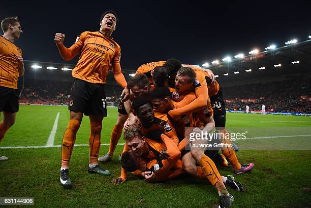 Matt Doherty of Wolverhampton Wanderers celebrates scoring his team's second goal with hsi team mates during The Emirates FA Cup Third Round match...