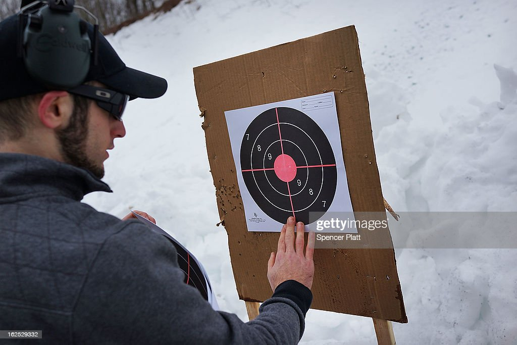 Matt Dolce looks at a target at a class taught by King 33 Training at a shooting range on February 24, 2013 in Wallingford, Connecticut. King 33 Training, a company that trains and educates individuals on the safe and proper use of guns and other uses of protective force, offers classes to marksmen of all levels. The Connecticut company offers training for clients interested in maintaining a safe environment for themselves, their families, and those around them. Connecticut, home to a number of gun manufactures including Colt Defense, is a state with conflicting views on guns and gun ownership. Currently the state has some of the strictest gun control laws in the nation and its current governor Daniel Malloy is pushing for tougher measures following the shootings at the Sandy Hook School.