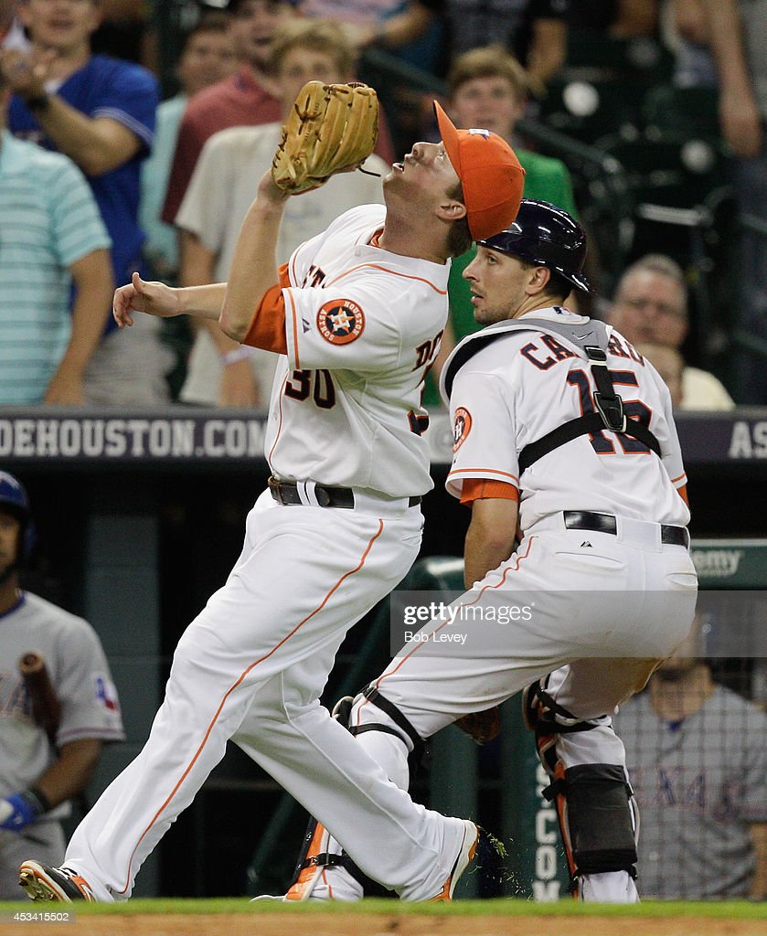 <a gi-track='captionPersonalityLinkClicked' href=/galleries/search?phrase=Matt+Dominguez&family=editorial&specificpeople=2934044 ng-click='$event.stopPropagation()'>Matt Dominguez</a> #30 of the Houston Astros calls off Jason Castro #15 as he makes a catch on a pop fly by Rougned Odor #12 of the Texas Rangers in foul territory at Minute Maid Park on August 9, 2014 in Houston, Texas.