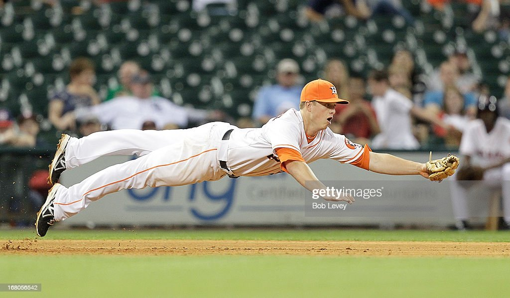 <a gi-track='captionPersonalityLinkClicked' href=/galleries/search?phrase=Matt+Dominguez&family=editorial&specificpeople=2934044 ng-click='$event.stopPropagation()'>Matt Dominguez</a> #30 of the Houston Astros dives but can't reach a line drive hit by Matt Tuiasosopo #18 of the Detroit Tigers in the ninth inning at Minute Maid Park on May 4, 2013 in Houston, Texas.