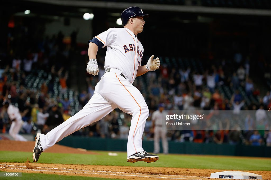 Matt Dominguez #30 of the Houston Astros drives in the winning run with an RBI single in the ninth inning of their game against the Texas Rangers at Minute Maid Park on May 14, 2014 in Houston, Texas.