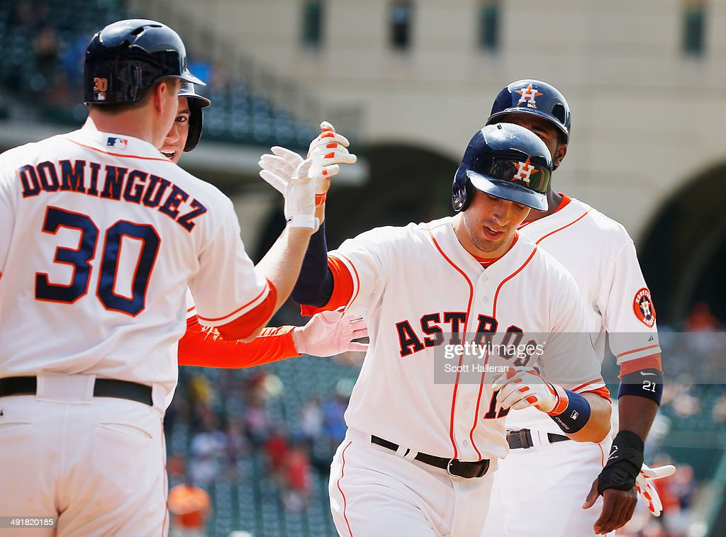 Matt Dominguez #30 of the Houston Astros greets Jason Castro #15 after Castro hit a three-run home run in the first inning of their game against the Chicago White Sox at Minute Maid Park on May 17, 2014 in Houston, Texas.