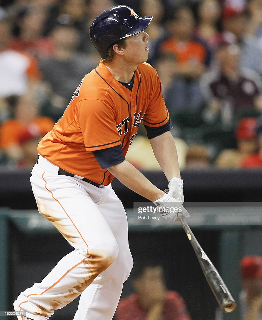 <a gi-track='captionPersonalityLinkClicked' href=/galleries/search?phrase=Matt+Dominguez&family=editorial&specificpeople=2934044 ng-click='$event.stopPropagation()'>Matt Dominguez</a> #30 of the Houston Astros hits a grand slam against the Los Angeles Angels of Anaheim in he fifth inning at Minute Maid Park on September 13, 2013 in Houston, Texas.